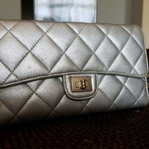 Authentic Chanel Silver Metallic Bi-fold Wallet